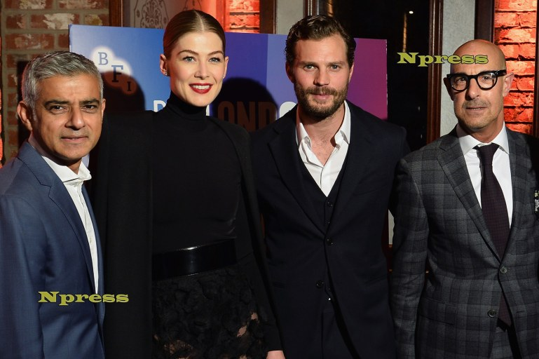 Stanley Tucci, Rosamund Pike and Jamie Dornan